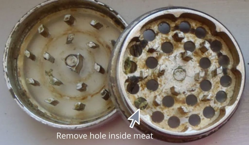 Dirty meat grinder plate